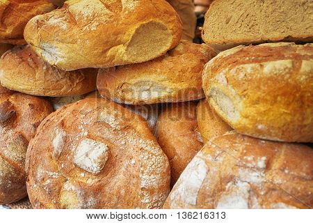 Heap of fresh baked buns on trading tray