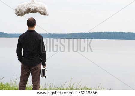 young business man with briefcase and storm cloud, concept of business problems
