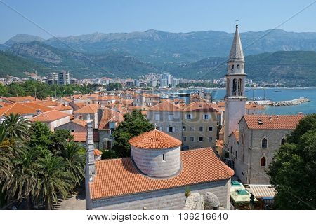 BUDVA, MONTENEGRO - JULY 09, 2015: Budva Old Town and bell tower St. John the Baptist, on background the modern town