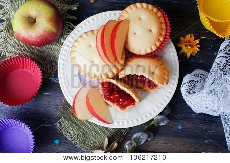 basket berry muffin cake with apple jam still life wooden table decorated with flowers muffin