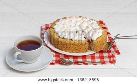 Sweet Cake Decorated With Meringue And Cup Of Tea