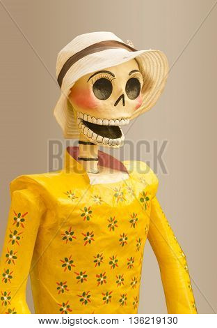 happy female skull with yellow dress with flowers