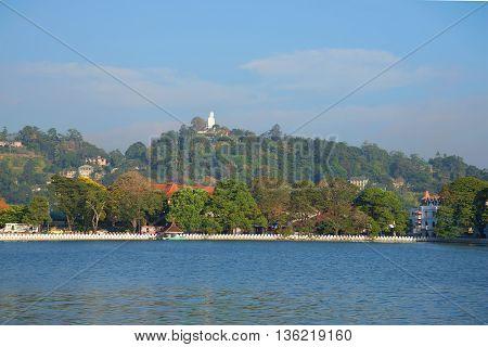 Artificial lake in the heart of city Kandy, sunny morning. Sri Lanka