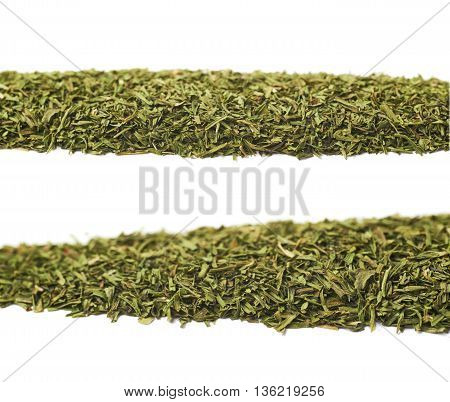 Line of dried dill seasoning isolated over the white background, set of two different foreshortenings