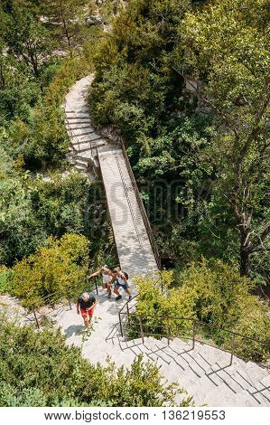Verdon, France - June 29, 2015: People Travelling Walking On Stone Steps Trail Path Way Mountain Road In Verdon Gorge In France. Scenic View