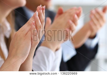 Close up view of business seminar listeners clapping hands. Professional education business meeting presentation or coaching concept