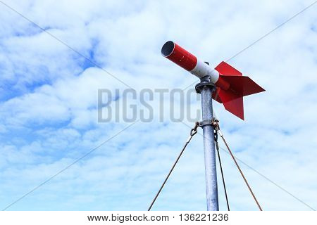 The measure wind direction in the red. Set amidst the blue sky Clouds drift more pronounced use of measuring wind direction. Allied planes were flying in the sky red in summer
