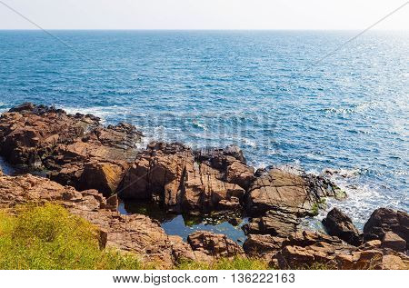 Beautiful picturesque seascape. Black Sea coast in bright sunny day. Rocky coast with large stone and.blue sea water.
