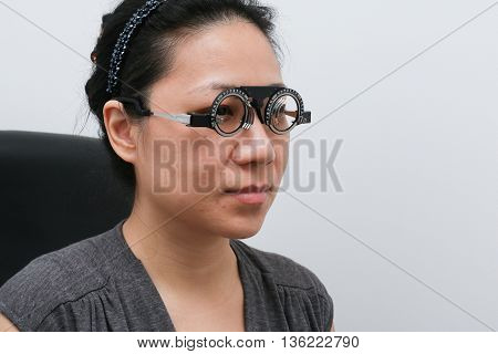 Asian Woman Doing Eyes Examination
