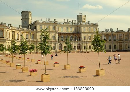 Russia.The planting of young trees in the Gatchina Palace.On the street the sun shines brightly.