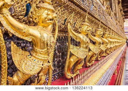 Golden garuda decoration on wall of main Buddhist church or