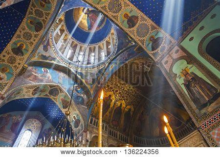 TBILISI, GEORGIA - APRIL 18, 2015: Murals and light beams in the Sioni Church, in Tbilisi, Georgia.
