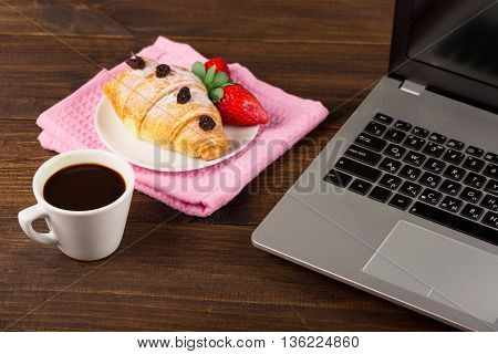 breakfast work with coffee and croissant. notebook