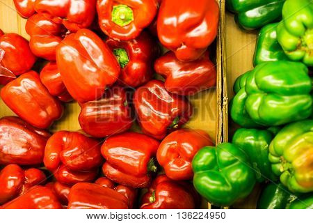 Red and green bell pepper from food supermaket ready for cooking food.Green and red colour for food.Many kind of food can make from this pepper likes Thai food Japan food Euro food. All food more better by put this in also get real taste from bell pepper.
