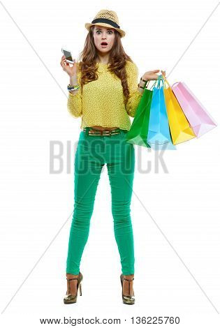 Surprised Woman In Hat With Shopping Bags And Smartphone
