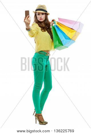 Woman In Hat With Shopping Bags Taking Selfie With Smartphone