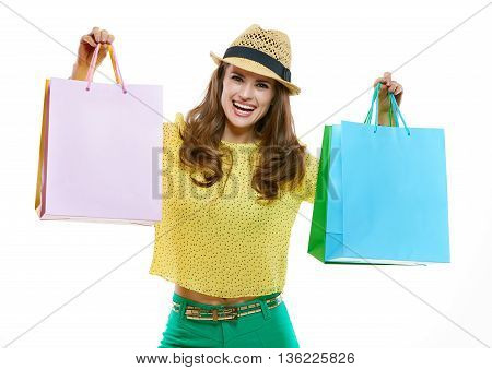 Happy Woman In Hat Showing Shopping Bags On White Background