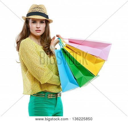 Brunette Woman In Hat With Shopping Bags On White Background