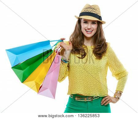 Smiling Woman In Hat With Shopping Bags On White Background