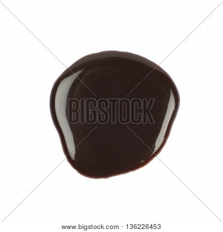 Round puddle of hot chocolate isolated over the white background