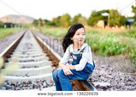 Girl Sit On Railway