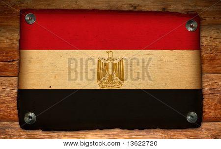 Old Egypt Flag On Antique Wood Backdrop