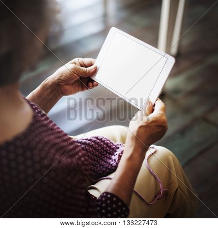 Senior Browsing Digital Device Concept