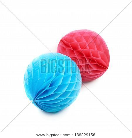 Blue and red honeycomb pom-pom paper balls decorations, composition isolated over the white background