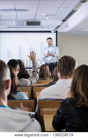 Activating His Students During A Lecture On Economy