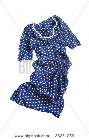 Blue silk dress with polka dots crumpled on white background
