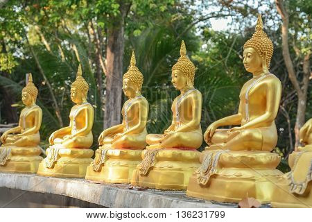 row of Buddha statues in Koh Phayam Thailand
