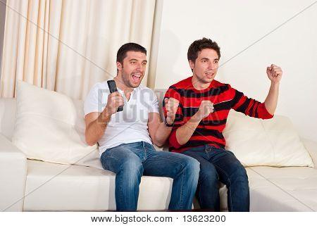 Two Men Watching Tv Soccer