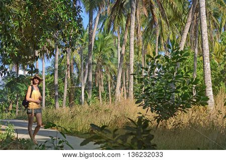 backpacking girl in Thailand jungle forest roads