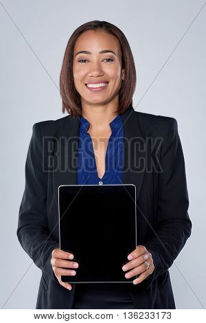 Hispanic latino woman smiling holding a tablet device with empty blank screen