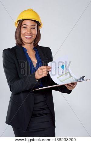 Mixed race woman in suit hardhat and clipboard, engineer consultant construction surveyor careers