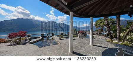 Porch of a beautiful terrace with ornamental garden, lake view