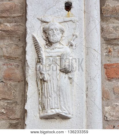 Medieval relief of Peter of Verona on St John and Paul basilica outside wall in Venice
