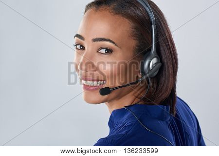 woman smiling with headset, call centre operator assistance isolated in studio