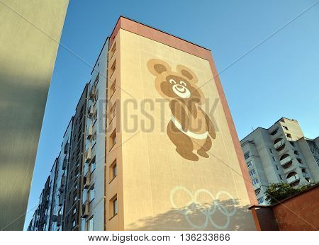 Grodno, Belarus - August 28, 2013: Windowless facade of a residential multistory building with a picture of the Soviet Olympic bear. Grodno, Belarus.