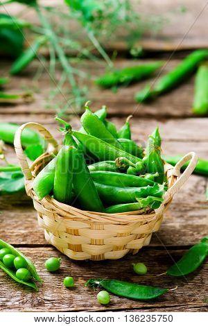 fresh organic green peas . selective focus