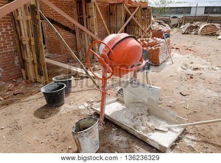 Concrete mixer container on local construction site