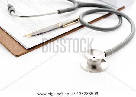 Stethoscope with Pen on Patient information
