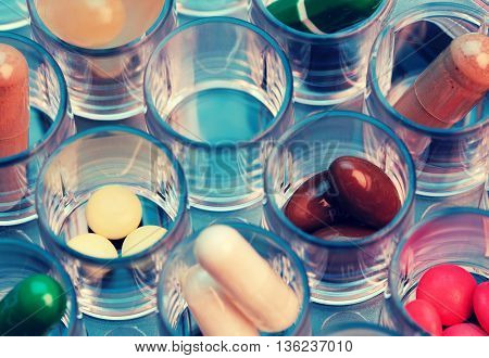 color pills and capsules in plastic tray