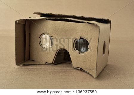 closeup of a pair cardboard virtual reality lenses on a cardboard background