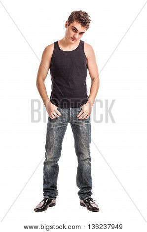 cute young man in jeans and t-shirt looking at the camera against white background