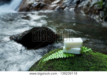 Alternative Skin Care Homemade Soap On Stone, Green Leaf With Tropical Waterfall In The Background.