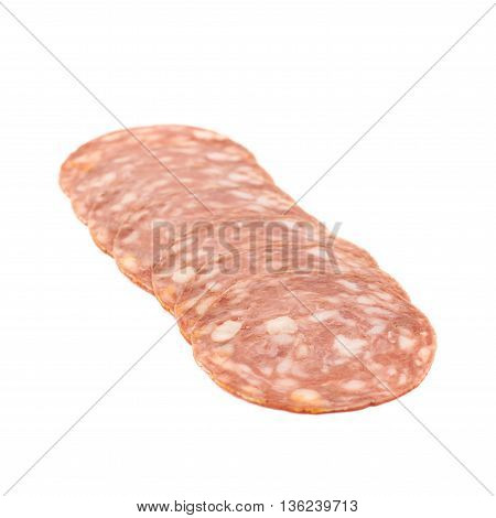 Line of sliced Italian sausage salame napoli isolated over the white background