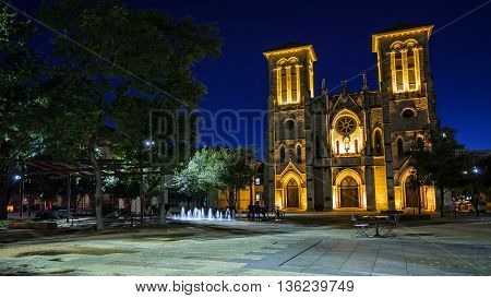 Water fountain and San Fernando Cathedral in San Antonio Texas at night