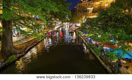 View along the famous San Antonio River Walk at Night in San Antonio Texas
