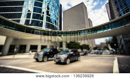 Traffic and office buildings in downtown Houston Texas during the day